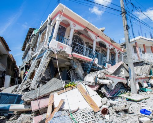 FILE PHOTO: A view shows houses destroyed following a 7.2 magnitude earthquake in Les Cayes, Haiti August 14, 2021. REUTERS/Ralph Tedy Erol NO RESALES. NO ARCHIVES/File Photo